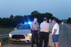 "<div class=""source"">Leslie Moore</div><div class=""image-desc"">Marion County Sheriff Jimmy Clements, far right, and Taylor County Sheriff Allen Newton, right, talk with other law enforcement personnel after the capture of Ricky Garrett on KY 70 in Mannsville.</div><div class=""buy-pic""><a href=""/photo_select/54832"">Buy this photo</a></div>"