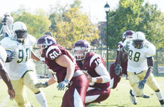 """<div class=""""source"""">Bobby Brockman</div><div class=""""image-desc"""">Quarterback Ross Deaton (18), at left, uses a block to avoid a sack. Coach Perry Thomas' team travels to Georgetown College on Saturday before hosting the University of the Cumberlands on Nov. 1 at Ron Finley Stadium.</div><div class=""""buy-pic""""><a href=""""http://web2.lcni5.com/cgi-bin/c2newbuyphoto.cgi?pub=085&orig=rossdeaton.jpg"""" target=""""_new"""">Buy this photo</a></div>"""