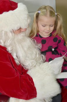 """<div class=""""source"""">Calen McKinney</div><div class=""""image-desc"""">Rose Harmon reads the letter she wrote to Santa. Harmon received second place in the girl category of the News-Journal's annual Letter to Santa contest.</div><div class=""""buy-pic""""><a href=""""/photo_select/48958"""">Buy this photo</a></div>"""