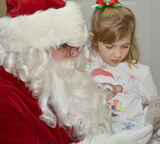 """<div class=""""source"""">Calen McKinney</div><div class=""""image-desc"""">Sammy Hesson shows Santa the picture she colored as an entry in the News-Journal's annual Christmas Coloring Contest. Hesson was chosen as one of five runners-up in the contest.</div><div class=""""buy-pic""""><a href=""""/photo_select/48961"""">Buy this photo</a></div>"""