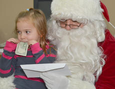 """<div class=""""source"""">Calen McKinney</div><div class=""""image-desc"""">Avery Hunt isn't so sure about talking with Santa, but is excited to receive the prize she won after being chosen as the third-place girl winner in the News-Journal's annual Letter to Santa contest.</div><div class=""""buy-pic""""><a href=""""/photo_select/48962"""">Buy this photo</a></div>"""