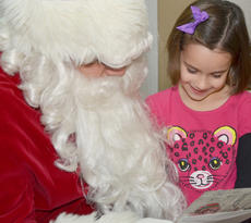 """<div class=""""source"""">Calen McKinney</div><div class=""""image-desc"""">Abigail Propes shows Santa the picture she colored as an entry in the News-Journal's annual Christmas Coloring Contest. Propes was chosen as one of five runners-up in the contest.</div><div class=""""buy-pic""""><a href=""""/photo_select/48963"""">Buy this photo</a></div>"""