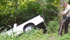 "<div class=""source"">Calen McKinney</div><div class=""image-desc"">Taylor County Sheriff's Deputy Branden Wilson writes information for a report about a crash involving this truck, which landed on its side in a ditch after the driver, Johnny T. Embry of Campbellsville, lost control.</div><div class=""buy-pic""><a href=""/photo_select/54750"">Buy this photo</a></div>"