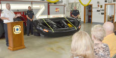 """<div class=""""source"""">Calen McKinney</div><div class=""""image-desc"""">Capt. Chris Taylor, leader of the Campbellsville Fire & Rescue swift water rescue team, tells Larry Stokes' family members how the new rescue boat they helped pay for will help his rescue team.</div><div class=""""buy-pic""""><a href=""""/photo_select/52748"""">Buy this photo</a></div>"""