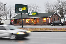 """<div class=""""source"""">Jeff Moreland</div><div class=""""image-desc"""">Local businesses like Subway on East Broadway will be affected if a minimum wage increase is made law. Sheila Parker, manager of the Subway location, said it could mean price increases, or even selling the business.</div><div class=""""buy-pic""""><a href=""""http://web2.lcni5.com/cgi-bin/c2newbuyphoto.cgi?pub=085&orig=subwayweb.jpg"""" target=""""_new"""">Buy this photo</a></div>"""