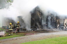 """<div class=""""source"""">Leslie Moore</div><div class=""""image-desc"""">Lightning is the suspected cause of a fire that destroyed this home on Swallows Lane off Elk Horn Loop around 2 p.m. Wednesday, according to Taylor County Fire & Rescue Chief George Wilson. About 25 personnel with three fire trucks worked to contain the blaze. At one point, firefighters were forced to evacuate the structure due to concern that it could collapse. Campbellsville Fire & Rescue, Taylor County Sheriff's Office, and CTCEMS also assisted at the scene. </div><div class=""""buy-pic""""><a href=""""/photo_select/51931"""">Buy this photo</a></div>"""