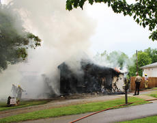 """<div class=""""source"""">Leslie Moore</div><div class=""""image-desc"""">Lightning is the suspected cause of a fire that destroyed this home on Swallows Lane off Elk Horn Loop around 2 p.m. Wednesday, according to Taylor County Fire & Rescue Chief George Wilson. About 25 personnel with three fire trucks worked to contain the blaze. At one point, firefighters were forced to evacuate the structure due to concern that it could collapse. Campbellsville Fire & Rescue, Taylor County Sheriff's Office, and CTCEMS also assisted at the scene. </div><div class=""""buy-pic""""><a href=""""/photo_select/51932"""">Buy this photo</a></div>"""