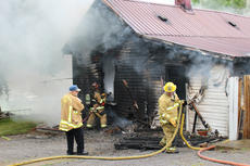 """<div class=""""source"""">Leslie Moore</div><div class=""""image-desc"""">Lightning is the suspected cause of a fire that destroyed this home on Swallows Lane off Elk Horn Loop around 2 p.m. Wednesday, according to Taylor County Fire & Rescue Chief George Wilson. About 25 personnel with three fire trucks worked to contain the blaze. At one point, firefighters were forced to evacuate the structure due to concern that it could collapse. Campbellsville Fire & Rescue, Taylor County Sheriff's Office, and CTCEMS also assisted at the scene. </div><div class=""""buy-pic""""><a href=""""/photo_select/51935"""">Buy this photo</a></div>"""
