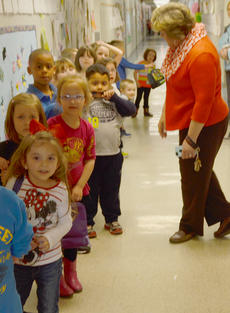"<div class=""source"">Calen McKinney</div><div class=""image-desc"">Taylor County School students will go to school through May 23 to make up days canceled for snow. Above, Taylor County Elementary School Principal Donna Williams greets kindergarten students in the hallway.</div><div class=""buy-pic""><a href=""/photo_select/50955"">Buy this photo</a></div>"