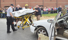 "<div class=""source"">Calen McKinney</div><div class=""image-desc"">Campbellsville/Taylor County EMS and Campbellsville Fire & Rescue personnel staged a mock crash at Taylor County High School on Thursday. Hayden McCubbin, in a body bag on a stretcher, was one of two students who ""died"" in the crash.</div><div class=""buy-pic""><a href=""/photo_select/51447"">Buy this photo</a></div>"