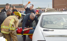 "<div class=""source"">Calen McKinney</div><div class=""image-desc"">Campbellsville/Taylor County EMS and Campbellsville Fire & Rescue personnel staged a mock crash at Taylor County High School on Thursday. Cianna Walters, being removed from the vehicle, was one of two students who ""died"" in the crash.</div><div class=""buy-pic""><a href=""/photo_select/51452"">Buy this photo</a></div>"