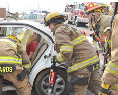 "<div class=""source"">Calen McKinney</div><div class=""image-desc"">Campbellsville Fire & Rescue fire fighters work to free victims in a mock crash at Taylor County High School. But Cianna Walters, above, a passenger in the vehicle, ""died"" of her injuries.</div><div class=""buy-pic""><a href=""/photo_select/51439"">Buy this photo</a></div>"