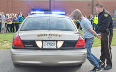 "<div class=""source"">Calen McKinney</div><div class=""image-desc"">Taylor County Sheriff's Deputy Branden Wilson ""arrests"" Taylor County High School student Marshall Steele as he participates in a mock exercise in which he drove drunk and caused a crash that killed two people.</div><div class=""buy-pic""><a href=""/photo_select/51441"">Buy this photo</a></div>"