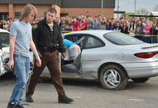 "<div class=""source"">Calen McKinney</div><div class=""image-desc"">Taylor County Sheriff's Deputy Branden Wilson talks to Taylor County High School student Marshall Steele as he participates in a mock exercise in which he drove drunk and caused a crash that killed two people.</div><div class=""buy-pic""><a href=""/photo_select/51444"">Buy this photo</a></div>"