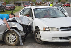 "<div class=""source"">Calen McKinney</div><div class=""image-desc"">Campbellsville/Taylor County EMS and Campbellsville Fire & Rescue personnel staged a mock crash at Taylor County High School on Thursday. Hayden McCubbin, on top of the vehicle at left, was one of two students who ""died"" in the crash.</div><div class=""buy-pic""><a href=""/photo_select/51446"">Buy this photo</a></div>"