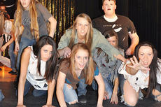 "<div class=""source"">Leslie Moore</div><div class=""image-desc"">Wearing tattered clothes and empty stares, members of the TCHS Show Choir become the undead for Michael Jackson's ""Thriller,"" voted the most influential pop music video of all time.</div><div class=""buy-pic""><a href=""/photo_select/50870"">Buy this photo</a></div>"