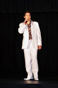"<div class=""source"">Leslie Moore</div><div class=""image-desc"">Dressed appropriately in a white suit, J.T. Agee sings George Jones' ""He Stopped Loving Her Today,"" widely considered the greatest country song of all time.</div><div class=""buy-pic""><a href=""/photo_select/50873"">Buy this photo</a></div>"