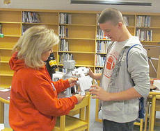 "<div class=""source""></div><div class=""image-desc"">Dalton Despain, a seventh-grade student at Taylor County Middle School explains how his robot works to teacher Jeanie Matney during Student Spotlight Night at the school. Students built robots and had them on display.</div><div class=""buy-pic""></div>"
