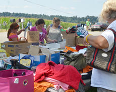 """<div class=""""source"""">Calen McKinney</div><div class=""""image-desc"""">Residents shop at a booth along the flea market, which extends the entire length of Tebbs Bend Road. </div><div class=""""buy-pic""""><a href=""""/photo_select/46961"""">Buy this photo</a></div>"""