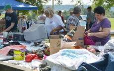 """<div class=""""source"""">Calen McKinney</div><div class=""""image-desc"""">Residents shop at a booth along the flea market, which extends the entire length of Tebbs Bend Road. </div><div class=""""buy-pic""""><a href=""""/photo_select/46962"""">Buy this photo</a></div>"""