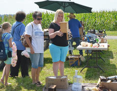 """<div class=""""source"""">Calen McKinney</div><div class=""""image-desc"""">Residents shop at a booth along the flea market, which extends the entire length of Tebbs Bend Road. </div><div class=""""buy-pic""""><a href=""""/photo_select/46963"""">Buy this photo</a></div>"""