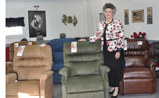 """<div class=""""source"""">Leslie Moore</div><div class=""""image-desc"""">Teresa Lynne Aldridge, owner of American Mobility Products, Inc., shows some of the special recliners available in her store.</div><div class=""""buy-pic""""><a href=""""/photo_select/47769"""">Buy this photo</a></div>"""