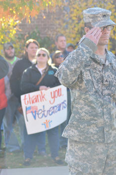 """<div class=""""source"""">Calen McKinney</div><div class=""""image-desc"""">American Legion Commander Phil Davis, at left, and Greg Collins, legion second vice commander, carry flowers to place on the Taylor County War Memorial.</div><div class=""""buy-pic""""><a href=""""/photo_select/48341"""">Buy this photo</a></div>"""