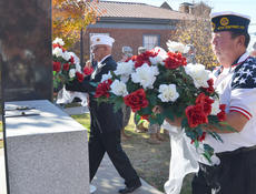 """<div class=""""source"""">Calen McKinney</div><div class=""""image-desc"""">American Legion Commander Phil Davis, at left, and Greg Collins, legion second vice commander, carry flowers to place on the Taylor County War Memorial.</div><div class=""""buy-pic""""><a href=""""/photo_select/48342"""">Buy this photo</a></div>"""