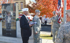 """<div class=""""source"""">Calen McKinney</div><div class=""""image-desc"""">American Legion Commander Phil Davis watches as National Guard soldiers change the flag by the Taylor County War Memorial.</div><div class=""""buy-pic""""><a href=""""/photo_select/48334"""">Buy this photo</a></div>"""