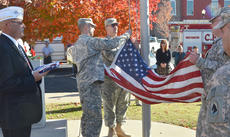 """<div class=""""source"""">Calen McKinney</div><div class=""""image-desc"""">American Legion Commander Phil Davis watches as National Guard soldiers change the flag by the Taylor County War Memorial.</div><div class=""""buy-pic""""><a href=""""/photo_select/48335"""">Buy this photo</a></div>"""