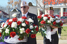 """<div class=""""source"""">Calen McKinney</div><div class=""""image-desc"""">American Legion Commander Phil Davis, at left, and Greg Collins, legion second vice commander, carry flowers to place on the Taylor County War Memorial.</div><div class=""""buy-pic""""><a href=""""/photo_select/48338"""">Buy this photo</a></div>"""
