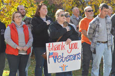 """<div class=""""source"""">Calen McKinney</div><div class=""""image-desc"""">More than 200 residents attended Monday's ceremony to honor the community's veterans.</div><div class=""""buy-pic""""><a href=""""/photo_select/48340"""">Buy this photo</a></div>"""