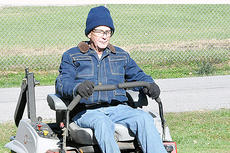 "<div class=""source"">Bobby Brockman</div><div class=""image-desc"">On a cool Oct. 31, Oval Tapscott needs a little extra clothing as he starts one of many weeks of mowing throughout Campbellsville. He will return to his normal schedule, which could be his last mowing this season, after taking a rare week off this week.</div><div class=""buy-pic""><a href=""/photo_select/66278"">Buy this photo</a></div>"
