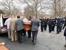 """<div class=""""source"""">City of Campbellsville</div><div class=""""image-desc"""">Officers with the Campbellsville Police Department stand at attention as the casket of George Williams, the city's first African-American police officer, is loaded into a hearse during his funeral Tuesday. </div><div class=""""buy-pic""""><a href=""""/photo_select/66729"""">Buy this photo</a></div>"""