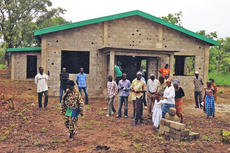 """<div class=""""source"""">Submitted</div><div class=""""image-desc"""">People in the village of Nassian walk around the construction site of their new church on Africa's Ivory Coast.</div><div class=""""buy-pic""""></div>"""