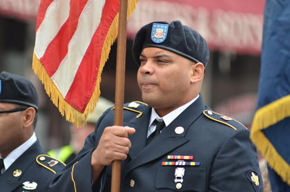 Aaron Webb walks as a member of the color guard in the parade.