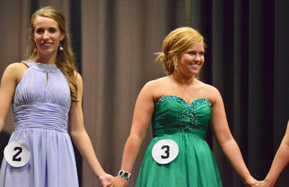 Hannah Howard, at left, and Taylor Smoot hold hands as they await the winners to be announced. Howard was named first runner-up and Smoot took home the spirit award.