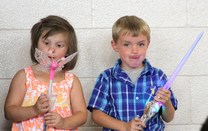 Friends, Emma Davis, left, and Benjamin Lord play with their light up circus toys.