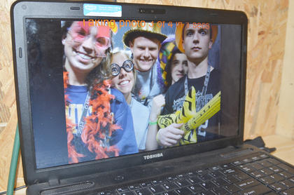 From left, Morgan Wilson, Rachel Riggs, Austin Sprowles, Nolan Slinker and Matthew Hart dress up and smile in the photo booth.