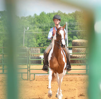 Griffin Blevins competes in the youth horse show.