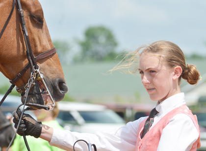 Channing Baker leads her horse during the competition.