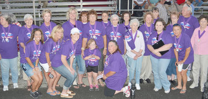 Cancer survivors gather for a group photo on Friday night.