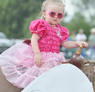 Zoey Bland of Campbellsville wears pink sunglasses to match her dress in the costume class.