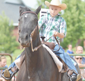 Dalton Reynolds of Campbellsville holds on to his horse tightly.