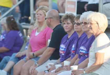 Cancer survivors listen to Friday night's opening ceremonies.