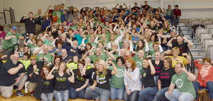 "St. Baldrick's participants and supporters flex to show they are ""Paxton Strong,"" in honor of Paxton Bloyd, the son of Campbellsville native Jamie Ennis Bloyd who is battling cancer. The Bloyds live in Lexington."