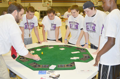 From left, Josh Hicks, Coty Hayden, Kyle Hedgespeth, Jody Harris and Tevin Taylor play their hand at Black Jack.