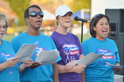 The new Relay for Life choir sings a song during opening ceremonies about those battling cancer not being alone.