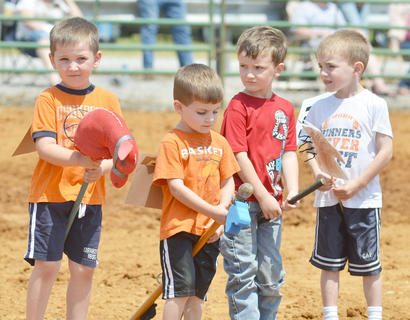 From left, Luke Adkinson, Brody Hines, J.T. Johns and Griffin Hines of Campbellsville line up for the judges in the stick horse competition. They all won first place.