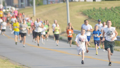 Nash Johnson, at left, and Eli Johnson, both of Greensburg, set the pace at the run.